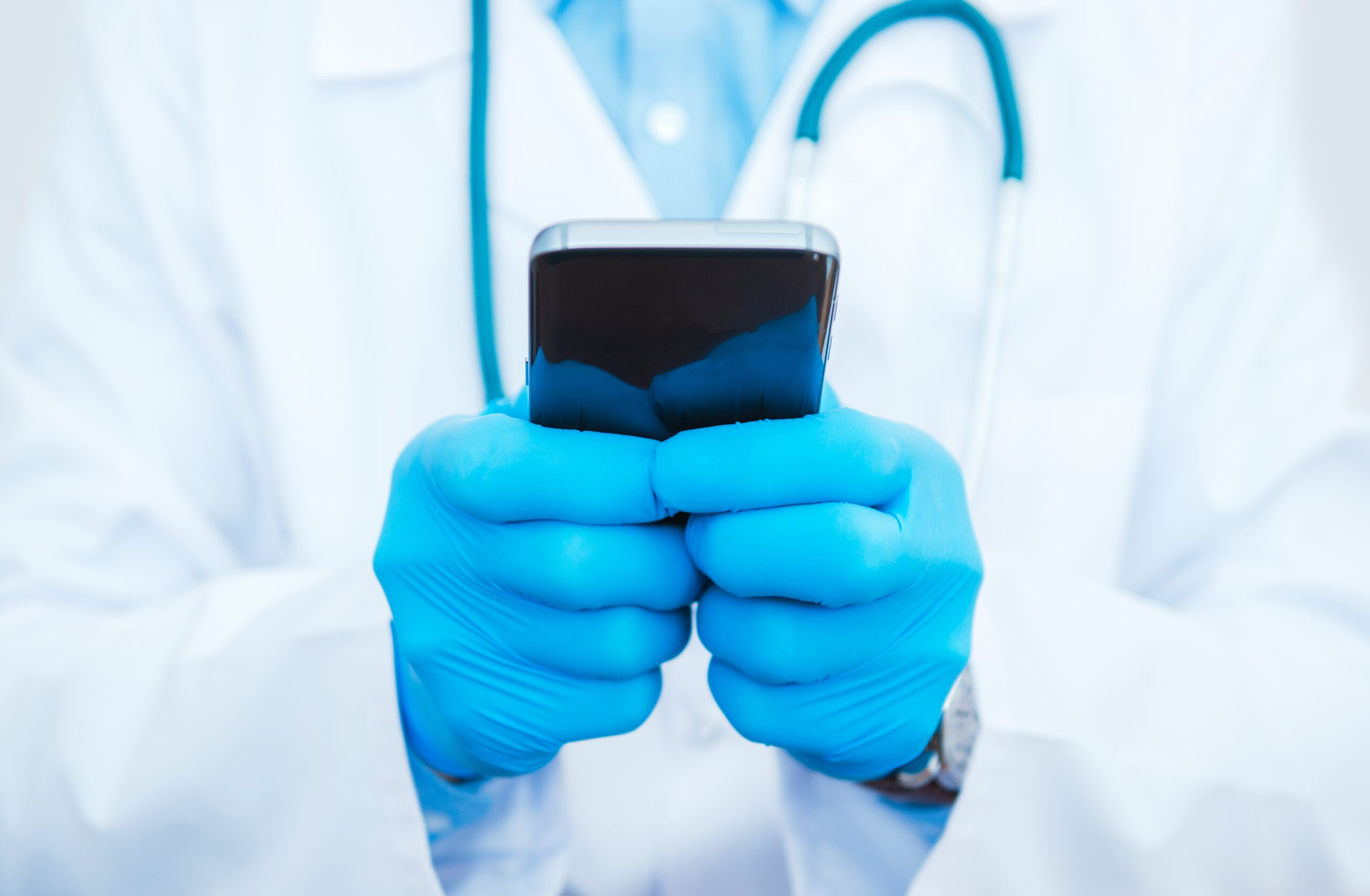 doctor with smartphone scaled